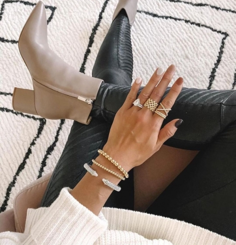 johnsonsjewelers-lady-in-black-tights-boots-wearing-silver-gold-rings-bracelets